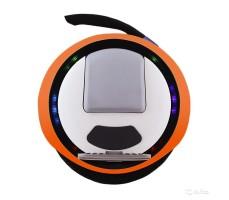 Фото моноколеса Ninebot ONE E+ Orange с ручкой для переноски