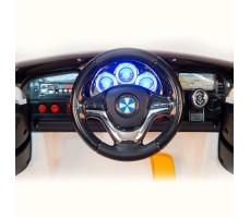фото руля и передней панели электромобиля Barty BMW X5 М555МР White