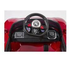 фото руля и передней панели электромобиля Barty М002Р Porsche 918 Spyder RedЭлектромобиль Barty М002Р Porsche 918 Spyder Red