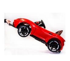фото электромобиля Barty Porsche Sport М777МР Red сбоку с ручкой