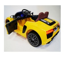 фото детского электромобиля RiverToys Audi R8 Yellow сзади