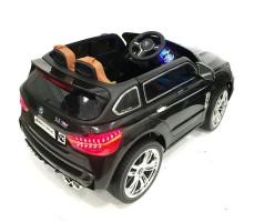 фото детского электромобиля RiverToys BMW E002KX Black сзади