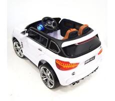 фото детского электромобиля RiverToys BMW E002KX White сзади