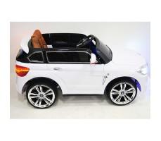 фото детского электромобиля RiverToys BMW E002KX White сбоку