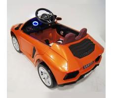 фото детского электромобиля RiverToys Е002ЕЕ Orange сзади