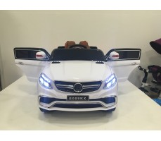 Фото электромобиля Mercedes E009KX White с открытыми дверьми
