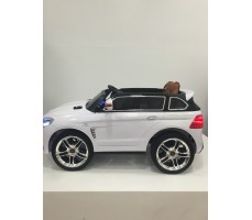 Фото электромобиля Mercedes E009KX White вид сбоку