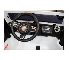 Электромобиль River Toys Jeep Wrangler O999OO 4x4 White вид сзади вид изкабины