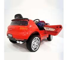 фото детского электромобиля RiverToys Porsche Macan O005OO VIP Red сзади