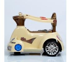 фото электромобиля-ходунков Rivertoys 1688 BeigeЭлектромобиль-ходунки Rivertoys 1688 Beige сбоку