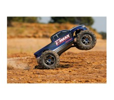 фото радиоуправляемой машины Traxxas E-Maxx 1/10 4WD Brushless TSM Blue and Silver в движении