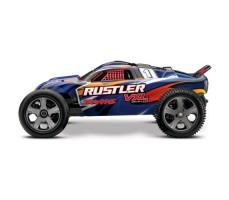 боковое фото радиоуправляемой машины TRAXXAS Rustler 4X4 1/10 Blue