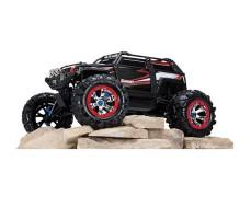 фото радиоуправляемой машины  Traxxas Summit 1/10 4WD Black сбоку на камнях